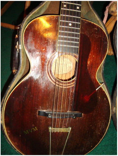 1922 L1 Gibson Guitar Played By Zappa Parsons Page GTOs  Taken from Miss P's ebay page… click the picture to see where you can bid!   When I was nineteen years old, I became a Flying Burrito Sister, a sidekick, pal and confidante to Gram Parsons, and a part time girlfriend to his partner, Chris Hillman. I spent a lot of time at 'Burrito Manor' in Nichols Canyon, dreaming of my own country-singing career. I already had my all-girl shock rock group, Girls Together Outrageously (or the GTOs —founded by Frank Zappa, our mentor), but since Gram had turned me on to the likes of Merle Haggard, George Jones and Waylon Jennings, my musical tastes had broadened considerably. From the time I was a tot, I had been hearing about my Aunt Mabel's 1922 L1 Gibson, the beloved guitar she'd discovered in a pawnshop in Pinsonfork, Kentucky in the mid-thirties. Mabel Virginia Miller finally caught a hubby late in life, a preacher called R.D. Brown, and every Sunday morning she warbled and played her Gibson for his devoted flock. She brought the guitar with her when she visited my aunties in L.A. one summer, announcing that she had only ever played songs for the Lord on it, before launching into 'What a friend We Have in Jesus,' accompanied by aunties Edna, Mary and Jewel in perfect sisterly harmony. Through the years, I secretly coveted the Miller heirloom with the fading gold MVM decals and 'The Gibson' inlayed into the neck. I imagined strumming along with Chris and Gram, sounding a bit like Linda Ronstadt in her Stone Pony days. It was 1969, and it had been several years since my bigger-than-life, drop-dead-handsome daddy, O.C. Miller had been back home. His adoring older sister, Mabel, longed desperately to see him, so I hatched a plan: I'd buy his airline ticket if he could bring the Gibson back with him. For little ME. Since Uncle R.D. had retired, the guitar wasn't played as often, so Aunt Mabel agreed, and a few weeks later, I held the precious instrument in my arms. I promised her I would also sing to Jesus, which I have been doing ever since. But as divine as the Gibson was, I wasn't a good music student. Too busy gallivanting about the Sunset Strip, I let my lovers and friends play it instead. And play it they did! I took it with me everywhere, showing off the Miller family heirloom to all and sundry. It was a magnet for musicians, who would reverently take it from its ancient original case like it was made of pure gold. It charmed Gram Parsons, and he played it quite a bit, Chris Hillman too. In fact, all the Flying Burrito Brothers took turns, loving its sweet, sweet sound. Little Feat's Lowell George, my dear pal and co-producer of the GTOs album, 'Permanent Damage,' spent an entire evening strumming it and serenading me into a swoon. Frank Zappa himself took a shine to the antique instrument and tweedled on it more than once. I sat between Jimmy Page and Robert Plant at my Hollywood apartment on Alfred Street while they passed it back and forth, playing the blues deep into the night. Jimmy wanted it for himself and offered me $2500, which was a fortune at the time, but I still thought I might miraculously turn into a country songbird some fine day. I did write a couple of GTOs songs on it, and a weepy ballad for Mr. Page called 'Come In from the Storm, Come Inside.' Woe was me and my Led Zep broken heart. Sigh. Waylon Jennings strummed a tune or two, and Keith Moon saw it in the corner of my guesthouse at the Zappa's and surprisingly thrashed away on it. When I hooked up with the young actor Don Johnson, (also a wonderful musician) he spent many nights playing his original tunes on it.      Through the years, I have placed the Gibson in the arms of many of my favorite musicians. My ex-husband, Michael Des Barres has played it countless times. Steve Jones of the Sex Pistols was our roommate, and gave our son Nick a few guitar lessons on it. One evening, the late Doug Feiger of the Knack played a dozen Beatle classics for me. Many talented fingers have plucked these strings. Ryan Adams was enthralled with it and crooned several of his new songs for me at the Sunset Marquis Hotel. My gifted girlfriend Lucinda Williams recently came by and played my beloved Gibson, entertaining a group of pals, enjoying every strum. Countless amazingly talented people have played this divine guitar, and I want to share it with someone who will appreciate its beauty, sweet sound, and unique incredible history. I want someone to own it who understands the value of vibes and energy. I will include a first edition of my first book, 'I'm With the Band,' and a feather boa I wore in the GTOs! It comes with original pick guard, and case, and the smell is ancient! The original sticker is still inside the center of this divine instrument as well…unfortunately no photographs. I never carried a camera around in those days like we do now. I was just living the rock and roll dream, and still am. I have been asked why I am selling this beauty.  I don't play and I want someone special to make it sing. And I'd like to help out my son who lives in Tokyo, the most expensive city in the world! XXX