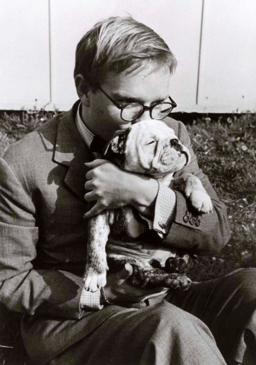 Truman Capote holding a pet dog, Italy, 1953 -by Robert Capa via ICP