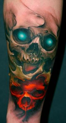 Words can't describe how awesome this tattoo by Jeff Gogue is. I love the colours and I especially love the way he does his skulls. It's a shame his website is actually horribly designed, because from what I can see, he is an extraordinarily talented tattoo artist.