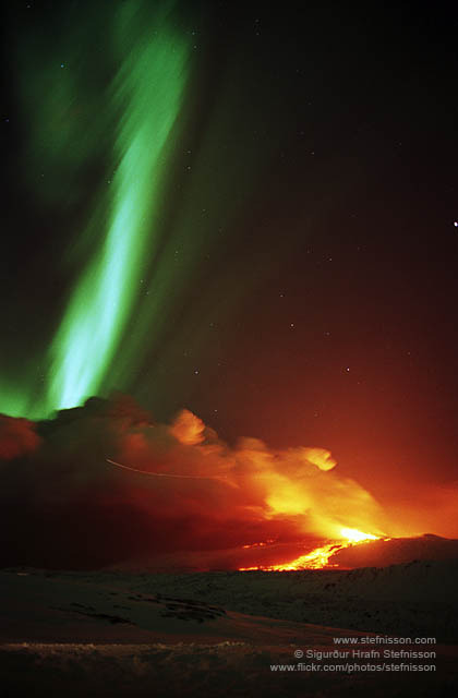 The recent Eyjafjallajökull eruption with the Aurora Borealis lighting up the sky above it. Check out more pictures on Sigurðurs flickr.