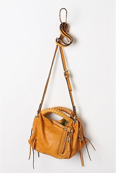 i can't take my eyes off the joni mini bag from anthropologie! i love everything about it: it's fresh, practical and would add the perfect dash of color to my winter wardrobe, which tends to be dominated by black. please little joni purse, be a part of my life!