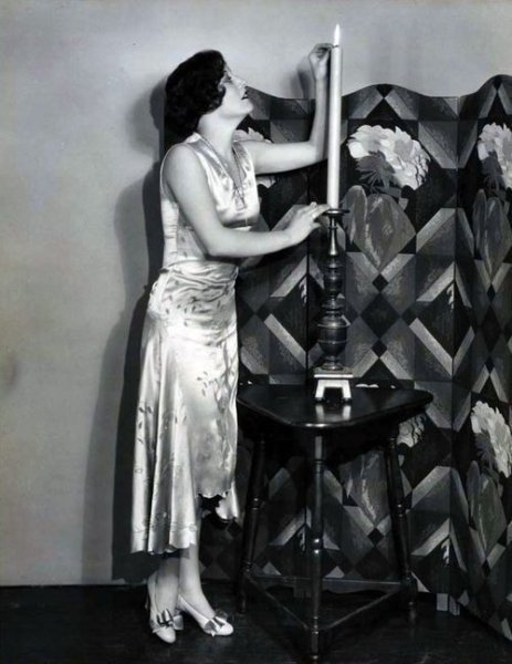 Joan Crawford and her giant candle C. Late 1920s/Early 1930s