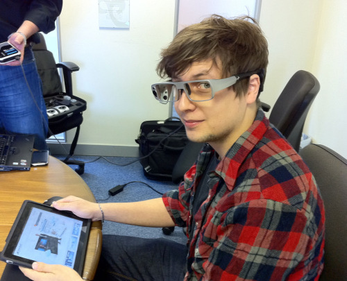 Gilbert trying out Tobii's eye tracking glasses on the iPad