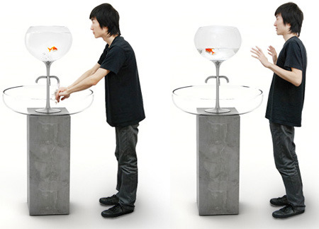 sunnyleeeee:   This Fishbowl Sink concept is a unique way to get people to preserve water. The water in the fishbowl decreases as you wash your hands. The idea is to force people to shut the water off in order to save the fish. Once the faucet is off, the water refills.  that's pretty good