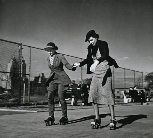 "baruchandroll:  [description: vintage photo of two women on rollerskates skating through a park. they are holding hands. on the left is a woman in a suit with awesome pants that puff out at the thighs and a scarf and a bowler-ish hat. on the left is a woman wearing a skirt suit with a vest and white gloves and a little golfer-ish hat and curly hair. her roller skates are attached to her shoes, which have two inch or so heels] liquidnight:  John Gutmann The Lesson Central Park, New York, 1935 From John Gutmann: The Photographer at Work  If this was facebook I would tag the woman on the left ""Julia Caron"" and the lady on the right as me. But in fact Julia doesn't have facebook so tumblr will have to do.  YES YES YESsssss. i love you iris."