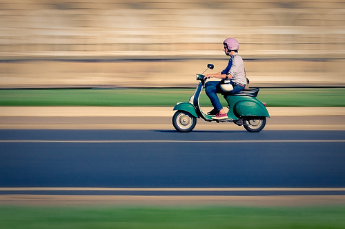 Photo: Green Vespa on the road
