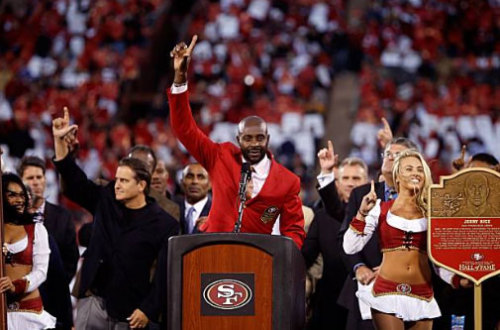 "putthison:  The greatest receiver ever, Jerry Rice, honored at Candlestick Park in San Francisco.  Looking very appropriately dressed in a 49ers red blazer (with crest).  A sporting man in sporting garb.  Thanks, Jerry!  Appropriately, 49er fans are asked to put their ""L's"" in the air."