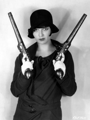 - Louise Brooks (with two pistolas)via PLuSH Papparazi