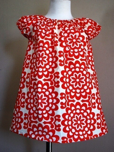 I have a weakness for handmade dresses. I've just ordered this one for Amelia. You can buy it here.