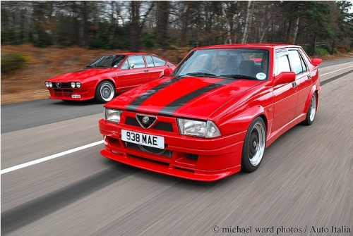 Alfa Romeo 75 3.5 V6. And an Alfetta, possibly the GTV6. Few things in life are as beautiful as an Alfa's V6 engine.