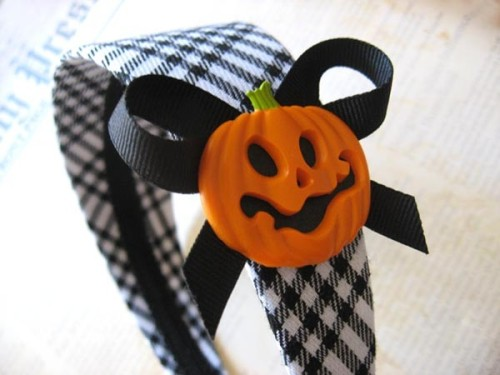 "My Black and White Plaid Pumpkin Headband is featured in this cute pumpkin-themed Treasury on Etsy. Go take a look!  This headband is wrapped with black and white plaid fabric. The inside has been finished off with black ribbon to compliment the plaid fabric. It is adorned with a 1.5"" x 1.5"" plastic jack-o-lantern and black ribbon bow. The headband is adjustable and is 2"" at its widest."