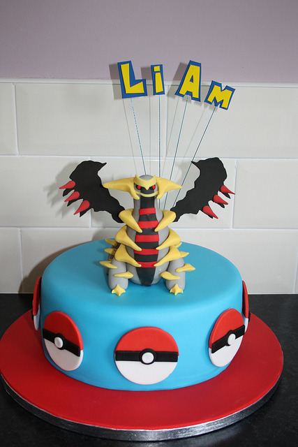 Badass Giratina Pokémon Cake is Badass. This cake Pokemon cake was made by cakes&cookies for her son's 11th birthday this past weekend. And the Giratina is made of friggin' Rice Crispie treats! This kid's mom obviously loves him more than your mother loves you. Sorry.