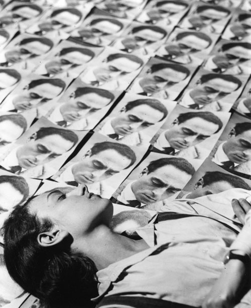 Eva Besnyö lying on the portraits she has made of a graphologist, Berlin 1932 by John Fernhout [orig.: Eva Besnyö liggend tussen haar portret van een grafoloog] from chagalov & NFM