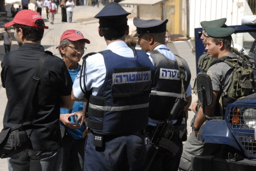 Police and IDF soldiers interrogate a Christian Peacemaking Team Volunteer in Hebron, The West Bank. The Last Friday of Ramadan 2009.