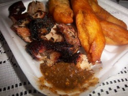 Real Jamaican food! Jerked Chicken with pepper sauce and festival