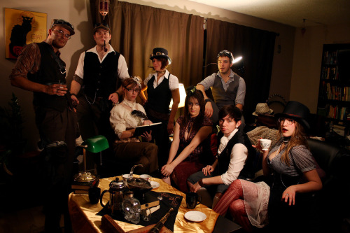 "So I did a Steampunk photoshoot this evening with my wonderful friends tousledbirdmadgirl, eveing, and a few other good friends who don't have tumblr. This is just one of several amazing photos we took tonight, but I think it sums up the whole evening pretty well. The premise was a Steampunk teahouse called ""Steam"". The brew of a century!"