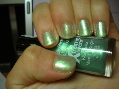 Lime Lights by Sally Hansen Xtreme Wear This is one of those colors that looks great in the bottle but ends up a mess on the nails. I forget whether this was two or three coats, but look at how sheer that is! I do wonder how it would have looked layered over white, but I don't believe in getting polishes that must be layered. Despite all the fuss about mints, it's rare to see a minty shimmer, which is why I was extra disappointed that this didn't turn out well.