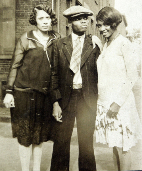 hilaryrakestraw:  Flapper girls and cool tough guy - 1920s I want to know their stories, because they look like they have so many to tell.  They look amazing.