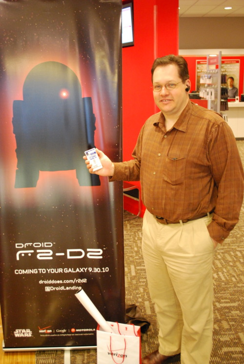 Frank J. Kautz, II, stands with the new Droid R2D2 at the Verizon  Wireless Communications store at 340 Washington Street in Boston. Kautz,  an attorney from Woburn, Mass, was the first customer to purchase the  limited edition smartphone in Boston. He bought the Droid R2D2 for his  wife, a Star Wars fan, to celebrate  her birthday. The Droid R2D2 is  available online at www.verizonwireless.com and  at select Verizon Wireless stores.