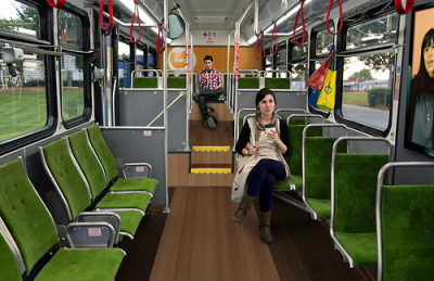 "erikatarte:  From ""Public Transportation"" to ""Community Transportation"", how the adaptive reuse of a public transportation system can solve pressing social problems The Grocery Loop is an innovative design solution to a pressing social problem. Built on the cost-effective and environmentally friendly model of adaptive reuse, The Grocery Loop is a public transportation system that provides access to nutrition while encouraging community engagement and promoting environmental sustainability.  Providence and many other cities are what Michelle Obama's Let's Move campaign calls a ""food desert"" — places where access to affordable, quality, and nutritious foods is limited. Over 30,000 households in the city of Providence live without easy access to healthy food (living over one mile from a grocery store) and although this presents an opportunity to encourage non-vehicular transportation, such a solution neglects many physical and financial limitations Ocean State residents face.  Unfortunately, the existing public transportation system leaves much to be desired. In a 2010 survey our The Grocery Loop conducted of a cross-section of the current RIPTA ridership, interviews revealed widespread frustration with linear routes, the impracticality of riding multiple routes to visit multiple grocery stores, and the lack of proper amenities for transporting food on buses and at bus shelters. Riders favored looping routes, such as the existing Trolley, and expressed a desire for accurate schedules and comprehensive route maps.  Above: Bus stops with inadequate signage, shelters, and seating are a common sight on existing RIPTA  routes.  Above: Without a comprehensive system map or interactive way to plan your trip, using the current RIPTA system can be difficult and intimidating. The Grocery Loop integrates amenity-based bus lines into the existing Rhode Island public transportation system (RIPTA). These low-emission, hybrid diesel buses run in a continuous loop stopping at a diverse selection of stores — from farmers markets, to specialty shops, to large grocery stores. Both buses and bus shelters provide seating and storage optimized for transporting food. Real-time GPS tracking information is displayed to keep riders informed of arrivals and departures. Once riders are on The Grocery Loop, they know exactly where they're going: to the grocery store.  The Grocery Loop empowers riders to take food and nutrition into their won hands. Attentive to the evolving needs of the ridership, The Grocery Loop's routes are informed by rider feedback. The Grocery Loop buses and website give riders the opportunity to suggest routes and schedules that fit into their busy lifestyle. Additionally, The Grocery Loop website allows riders to share recipes, generate grocery lists, suggest and review grocery stores, and connect to their fellow riders through social networking services.   The web and mobile components of The Grocery Loop provide an incredible opportunity to connect Rhode Islanders to additional resources about health and nutrition. By creating an engaging online presence, The Grocery Loop aims to keep riders ""in the loop"" of healthful resources throughout Rhode Island. This project has received the generous support of RISD with the award of a prestigious Graduate Studies Grant. The grant period allows for further design and development of The Grocery Loop's website, including key social networking and social media outreach components. A public outreach campaign to generate community interest and to organize community support will begin this Fall. The Grocery Loop is also participating in this year's Better World Challenge at the A Better World by Design conference, which begins tomorrow in Providence, RI. This year's challenge asked designers to tackle issues relating to urban food desserts. It will be exciting to see the spectrum of solutions other groups have proposed. The Grocery Loop is an ongoing collaborative project by Lindsay Kinkade, Erika Tarte, and Beth Weaver."