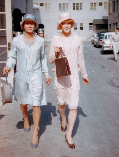 "oldhollywood:  Tony Curtis & Jack Lemmon on the set of Some Like It Hot (1959, dir. Billy Wilder) (via) ""We hung out a lot. After we made Some Like It Hot, we'd meet at parties, with movie people, dinner and dancing. And I'd always walk up to Jack's table, tap him on the shoulder, and  say, 'Would you like to dance?' And he'd get up and we'd waltz through  the dance floor. It was too good."" -Tony Curtis, excerpted from Dallas News interview, July 2002"