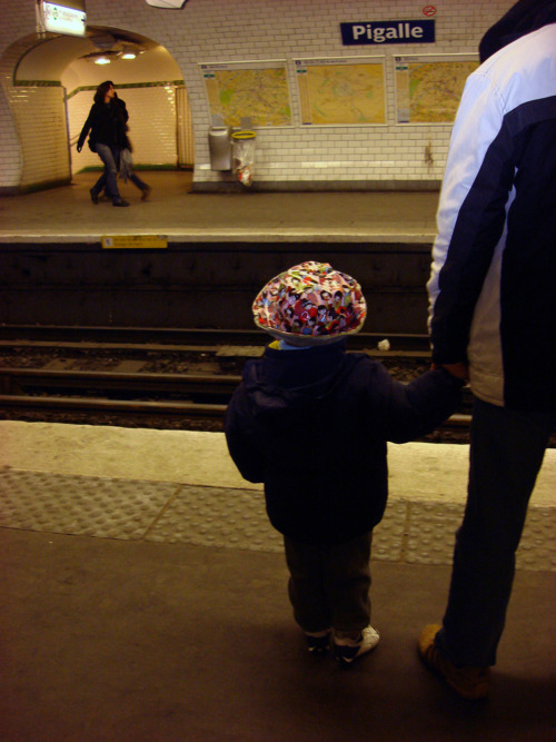 Little boy with his hat, waiting the train….