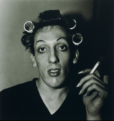 "Diane Arbus - ""A photograph is a secret about a secret. The more it tells you the less you know...I always thought of photography as a naughty thing to  do - that was one of my favorite things about it, and when I first did  it, I felt very perverse.…The world can only be grasped by action, not by contemplation. The hand is the cutting edge of the mind.""A young man in curlers at home on West 20th Street, N.Y.C., 1966 gelatin silver print stamped 'a diane arbus print', signed, numbered '4642-1-12U-1114' in ink by Doon Arbus, Administrator, and Estate copyright credit reproduction limitation stamps (on the verso) 9 1/8 x 8 5/8in. (23.6 x 22.4cm.)"