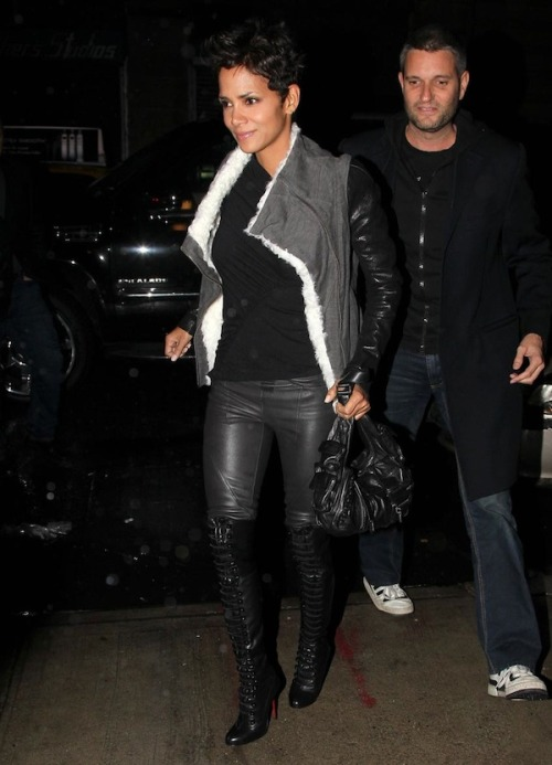 DAMN | Halle Berry To my lady friends, I post this in the name of fashion, but I ask for your forgiveness in advance if this blog makes me reek of a bacon, sausage, and ham salad.   But damn it, if Halle Berry in leather pants and knee high Louboutin boots isn't blogworthy then I just wouldn't be a man.  Ms. Berry was recently spotted in NYC rockin (and I mean ROCKIN) a Helmut Lang Shearling Jersey  Jacket, leather pants, and a pair of leather knee high boots  from Christian Louboutin. The Helmut Lang grey biker jacket has black  leather sleeves, a shearling fabric interior, and an asymmetrical zip  closure, but seriously, I don't even know if any of that really matters.  Did I mention the dope ass haircut?  Go Cindarella, Go Cindarella! This concludes this post, now back to our regularly scheduled programming.