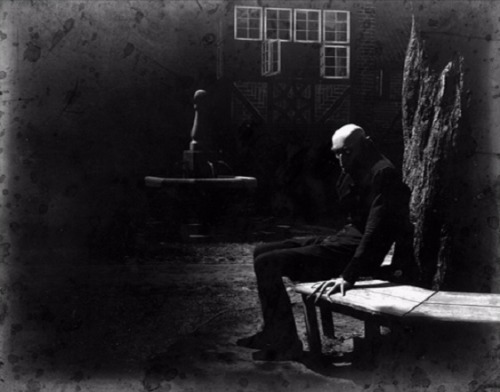 Max Schreck relaxing between takes & creeping everyone out on the set of Nosferatu, A Symphony of Horror(1922, dir. F.W. Murnau) (via)  During the filming of Nosferatu, Schreck reportedly stayed in character at all times, even when the cameras weren't rolling, and the cast and crew never saw him out of full makeup and costume. While this immersive approach to acting is commonplace now, it was unusual back then and his appearance & behavior led to wild rumors that Schreck actually was a vampire. If this photo is indicative of Schreck's demeanor around the set of Nosferatu, the crew's wariness was entirely understandable.