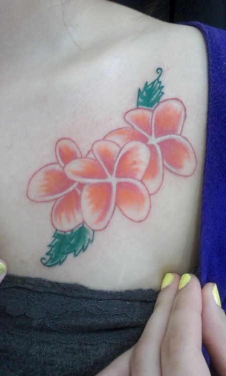 This is my tattoo. These are plumeria flowers which are my favorite.