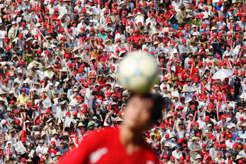 06 June 2009 | Spectators watch a V-league football match in Haiphong, Vietnam.  Vietnamese are mad about football. Mad. Mad. Mad. Mad. It's awesome.