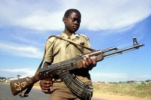 ihiphopalot:  A Child Soldier in Uganda. In Northern Uganda, a war that has started 20 years ago is still causing torment to the people. A man named Joseph Kony has his men kidnap children in the villages of the four surrounding countries of Uganda and builds an army with them. He forces them to kill or be killed. One person from the United States gets abducted and it'll make global news but over the past 20 years 30,000 children, ages 3-17, have been abducted AND forced to murder and we never even hear about it? THIRTY THOUSAND. Seriously, fuck the world for a) allowing Joseph Kony to do this unstopped for 20 years and b) for not publicizing this properly. This man is soon to reach the status of the modern day Adolph Hitler, he is responsible to genocide down there, yet oil prices are still our biggest concern. Educate yourselves and learn more. Seriously. http://www.invisiblechildren.com/history-of-the-war Honestly, I don't even know why I'm trying. This will probably get no attention because you all are too busy reblogging pictures of girls holding cameras or internet memes.