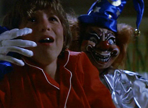 "31 Horror Movies I Own #7: Poltergeist""You moved the headstones, but not the graves!""Another Tobe Hooper masterpiece, Poltergeist is one of those rare horror movies that ages well. Despite its 1982 filming date, it doesn't really feel that dated (unless you pay attention to the electronics…) and still holds up. The story of the Freelings and their encounter with the group of ghosts living in their house could come of as campy and comical, especially with the inclusion of Zelda Rubenstein's squeaky-voiced Tangina. But this thing is so well written and packed with suspense, that it reads as straight-up terror. The focus of the film is the disappearance of angelic daughter Carol Anne, who joins the poltergeists by way of being sucked into a bedroom closet. Most horror films lose something in one area or another, but Poltergeist has the magic trinity of a strong script, kick-ass special F/X AND good actors. The build-up of ghostly activity coupled with the breakdown of parents Steve (Craig T. Nelson) and Diana (a smokin' hot Jo Beth Williams) is amazing to watch, and this is the movie that both made me afraid of large trees and ensured I would never have any kind of clown doll anywhere near me (look at that thing!), like FOREVER. If you've been avoiding this because you think it might be lame, or if you've only seen parts of it, I urge you to get over it and rent away. This movie is so fantastic that I love it a little more every time I watch it—and the ending is perfect. As far as the sequels go, 2 has its gross-out moments (the possessed tequila worm is pretty icktastic), and Kane is sufficiently creepy, but it's just not as good as the original. The 3rd is so bad it's *almost* good, in that ""let's knock back a couple of drinks and laugh our asses off"" kind of way…or you know, if you happen to enjoy watching a very young Lara Flynn Boyle scream a lot. I'm just sayin'."