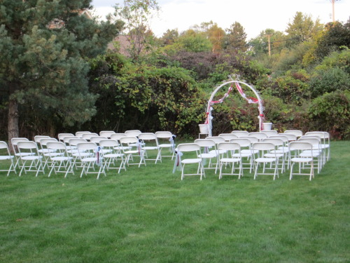 How the ceremony was going to look before there was rain! Isn't it pretty? There were roses around the edges of the arch and in the pots on the sides. I'm glad my Dad took these pre-wedding pictures!