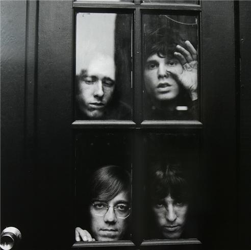 The Doors, looking through a window.
