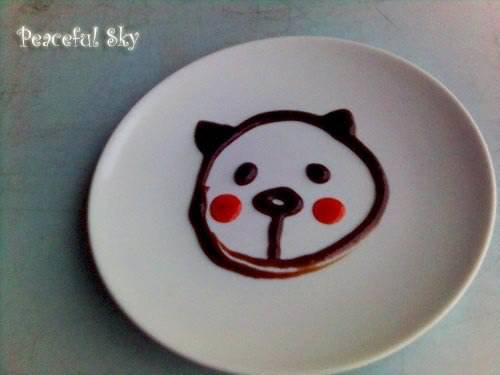 "A BEAR HEAD Using sweet sauce and Chilli sauce drawing a bear on a plate for fun when going out for a ""dim sum""…"