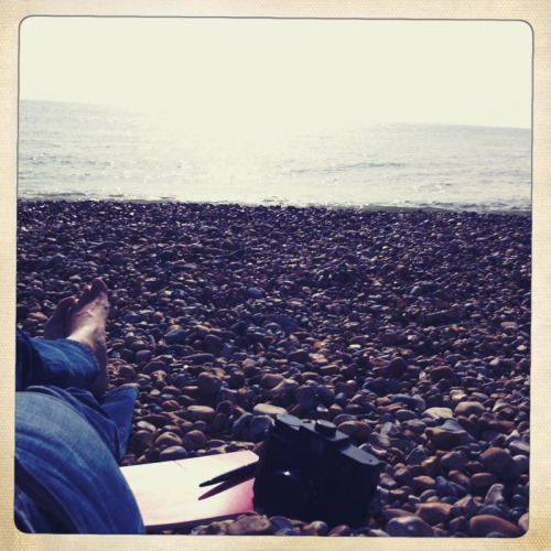 Me and my Holga about to get washed away on Brighton beach.  It's 22 degrees. It's hot. It's October.  It's the end of the world as we know it.  Good morning.