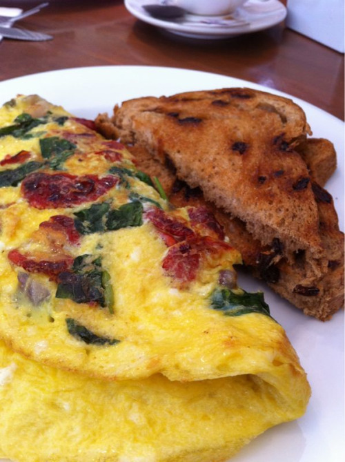Tuscan omelette with sundried tomatoes, spinach, feta, red onions, and basil.  Eureka Cafe in Los Angeles, CA.