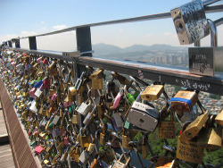 Seoul Tower- Locks of love.  You write your name and the name of the one you love, put it on the fence and throw away the key.