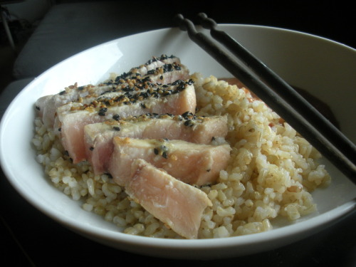 Seared swordfish with sushi rice and spicy Japanese dipping sauce This recipe works best when the swordfish is super fresh (look out for shiny, slightly pink and almost translucent steaks). Start by the preparing the rice: take 1 cup brown sushi rice and place in a pot with 2 cups water. Bring to a boil, then simmer for about 12 minutes. Switch off the heat and let the rice rest till all the water has been absorbed. In a bowl mix together 2 tbs rice vinegar with 1 tsp salt and 1 tsp sugar till dissolved. Transfer the rice to a bowl and stir in the rice vinegar using a flat spatula. Cover and set aside. To make the sauce: in a small bowl mix together 2 tbs mayonnaise, 1 tsp ketchup, 1 tsp mirin, 2 tsp soy sauce, and 1/2 tsp wasabi powder (or prepared wasabi will do). Heat 1 tsp rapeseed oil in a pan till quite hot, sprinkle black and white sesame seeds on both sides of 2 swordfish fillets. Sear the swordfish for about 1-2 minutes per side (depending on how rare you like your fish). Transfer to a cutting board and cut into slices across the grain.  To serve: divide the rice between two bowls, place the swordfish slices overtop and add a large dollop of sauce on the side. Serve 2. You may also be interested in: OKONOMIYAKI >