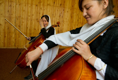 watanafghanistan:  Fekiria, 14 (left), practices the cello during class alongside Zahra, 14 at the Afghanistan National Institute of Music on September 26, 2010 in Kabul, Afghanistan. Afghanistan's first and only music high school