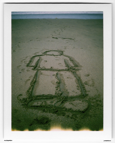 Day 210. Beach Grafitti Black Rock Bay, Cornwall, UK.   Polaroid Land Camera 240 and 125i film (expired 12/2007).   Polaroid photograph, all rights reserved, copyright: Jo Bradford 2010