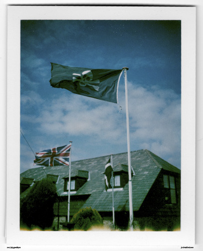 Day 212. Skull & Crossbones flying high, Pirates Ahoy! The Jamaica Inn, Bodmin Moor, Cornwall, UK.   Polaroid Land Camera 240 and 125i film (expired 12/2007).   Polaroid photograph, all rights reserved, copyright: Jo Bradford 2010