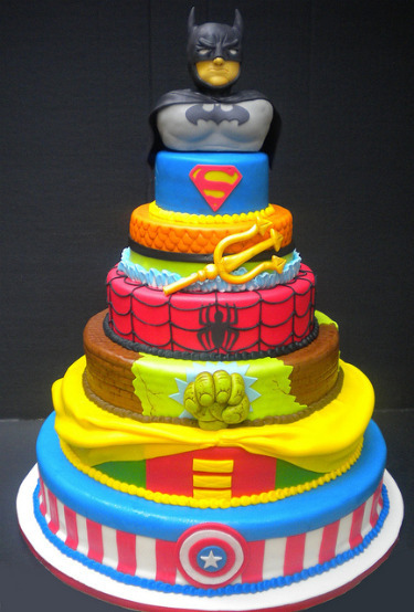 Superhero Totem Cake. This 7-layered cake features costume themes from 6 famous beloved superheroes… and one from Aquaman. Zing!