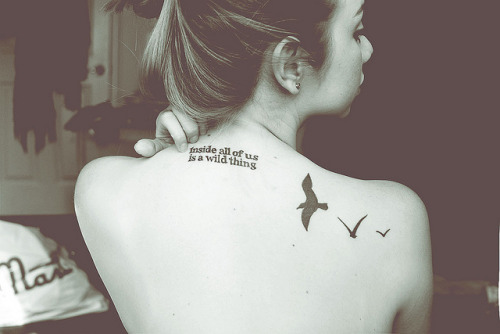 "fuckyeahtattoos:  My birds was the first tattoo I ever got. Three Little Birds - Bob Marley; That song just always makes me feel better. Always. And birds are my favorite animals. So beautiful, so free.  My second one was the quote from ""Where The Wild Things Are"" I used to be obsessed with that book when I was little. And I do believe what it says, inside all of us is a wild thing. :)"