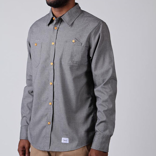ORISUE / URIST BUTTON-UP Orisue is an independent apparel label that blends hip-hop and skate culture.  It launched in 2006 with just a line of tees and sweatshirts, but has since exploded into a full men's line.  Unlike a lot of other streetwear brands, Orisue's designs are a bit more subtle and clean, with just a little bit of edge. We're especially digging the Urist Button-Up shirt from Orisue's current offerings.  It's understated and comfortable.  We especially like the way the front pockets are designed.  A nice touch. You can buy directly from Orisue online at its website.  You can also follow the label on Facebook and Twitter. $72