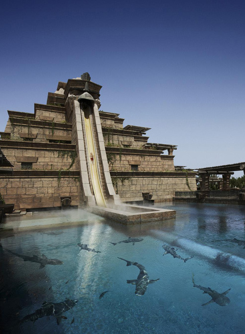 "hamandheroin:  ""The Leap of Faith slide (at the Atlantis Bahamas Resort) offers the daring and adventurous a 60 ft. almost-vertical drop from the top of the world-famous and iconic Mayan Temple, propelling riders at a tremendous speed through a clear acrylic tunnel submerged in a shark-filled lagoon.""  Awesome."