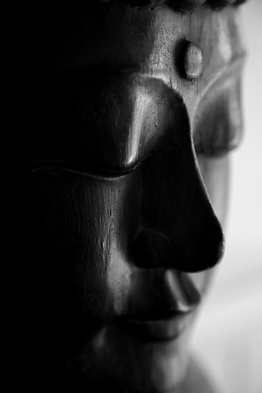bodhiimages:  wooden carved buddha head © tim buckley | bodhi images