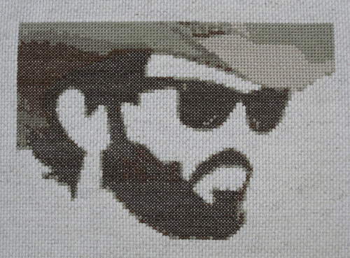 crackerfinishingschool:  Scott Avett in cross stitch (by ptolemyclark) Scott Avett of The Avett Brothers, one of the best indie/Americana bands around, in cross stitch.  I created the pattern based on this original photo from LayySayy on Flickr.  Darling, this is your best cross stitch yet!!  Gorgeous!!