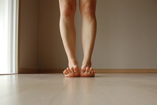 Lift your toes. Ground down the heels and roots of the toes.